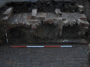Partially excavated brick burial vaults from beneath the front entrance steps to St Paul's church.