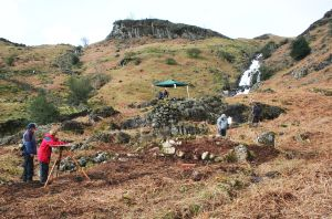 Volunteers doing both plane table and theodolite surveying at Sourmilk Gill, Easedale