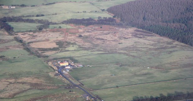 View of Eden House and the rough grazing behind it that contains the cairnfield